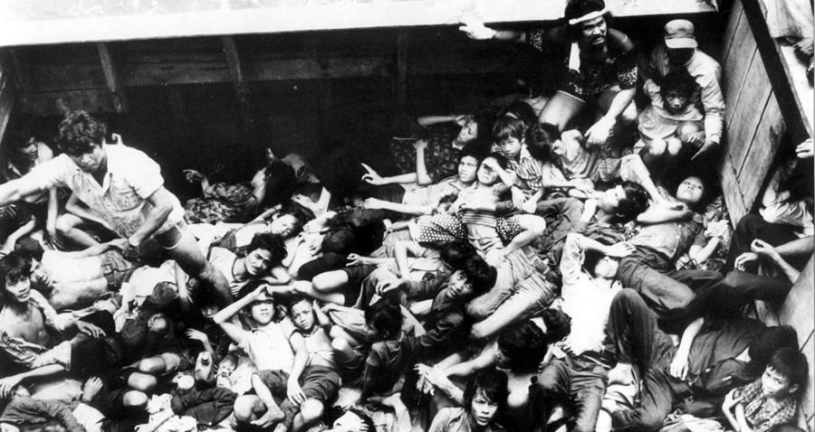 People packed tightly onto a boat with no room to move