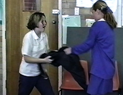 Students arguing as they tug on a jumper - dramatising conflict