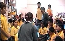 Primary aged students participating in drama activities