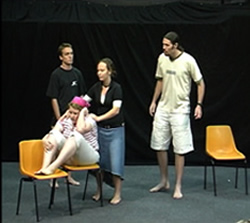 Students performing a scene depicting conflict