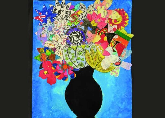 Vase with brightly coloured flowers