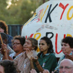 people marching with sign - Thank you Kevin Rudd