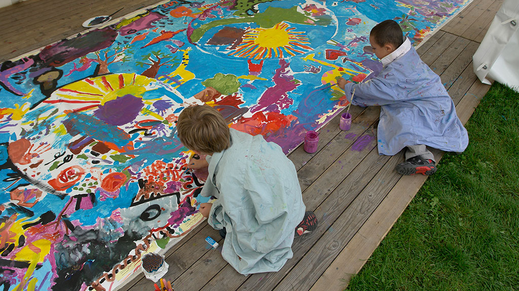 Children painting a colourful mural