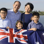 Family holding Australian flag on Citizenship Day