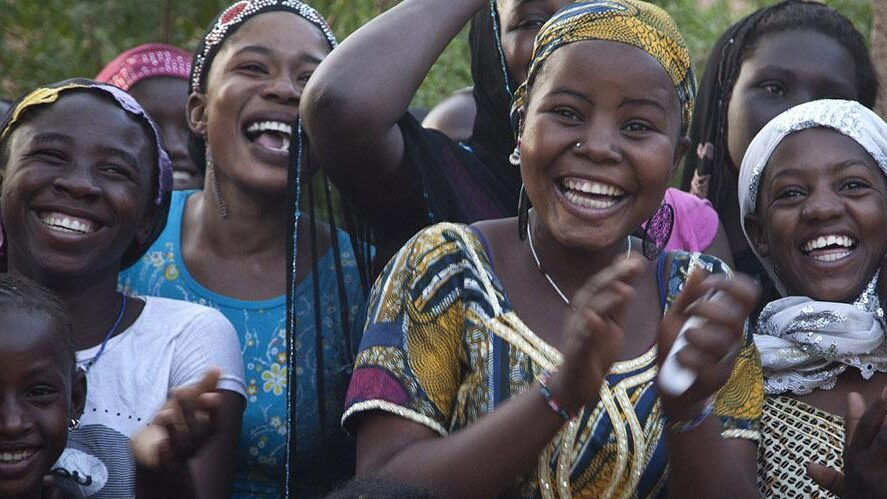 Smiling, laughing women at a Peace performance